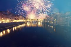 Florence with fireworks - Celebrating New Year in the city. Explosive fireworks around Ponte Vecchio on River Arno - Celebrating New year`s eve in Florence Stock Photos