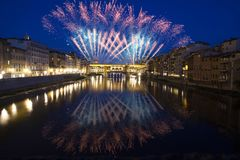 Florence with fireworks - Celebrating New Year in the city. Explosive fireworks around Ponte Vecchio on River Arno - Celebrating New year`s eve in Florence Royalty Free Stock Photos