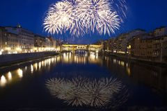 Florence with fireworks - Celebrating New Year in the city. Explosive fireworks around Ponte Vecchio on River Arno - Celebrating New year`s eve in Florence Royalty Free Stock Photography