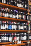 Bottles of wine on shelves in a store in Italy Stock Images