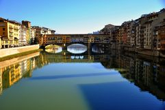 Florence , Italy. Urban secene in Florence city , Italy . Ancient bridge over the main river called Arno. Ponte Vecchio , the old bridge on a winter day Royalty Free Stock Images