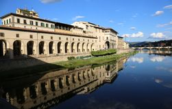 Florence Italy ancient monument called Corridoio del Vasari in i. Ancient monument called Corridoio del Vasari in italian language and the Arno River in Florence Stock Image