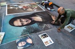 Man paints the Mona Lisa in chalk on the street in Florence. Florence, Italy - Apr 23, 2017: Man paints the Mona Lisa in chalk on the street Royalty Free Stock Photos