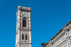 Campanile of Giotto a sunny day of summer in Florence. Florence, Italy - August 23, 2016: Campanile of Giotto a sunny day of summer. It is a free standing Stock Photos