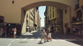 Tourists walking in old Firenze city sightseeing landmarks. Florence, Italy - August 1, 2019: Tourists walking in old Firenze city sightseeing landmarks stock video footage
