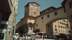 Tourists walking in old Firenze city sightseeing landmarks. Florence, Italy - August 1, 2019: Tourists walking in old Firenze city sightseeing landmarks stock footage
