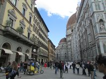 Florence, Italy, the central square. Crowds of tourists. On the left is the Catholic temple complex. Tourism, holidays, attractions, lifelong impressions stock photo