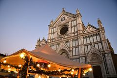 Florence, ITALY - DECEMBER 2018: Christmas Market in front of the `Basilica of Santa Croce`. Xmas atmosphere royalty free stock photo
