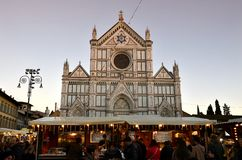 Florence, ITALY - DECEMBER 2018: Christmas Market in front of the `Basilica of Santa Croce`. Xmas atmosphere royalty free stock images
