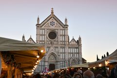 Florence, ITALY - DECEMBER 2018: Christmas Market in front of the `Basilica of Santa Croce`. Xmas atmosphere stock images