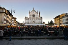 Florence, ITALY - DECEMBER 2018: Christmas Market in front of the `Basilica of Santa Croce`. Xmas atmosphere stock image