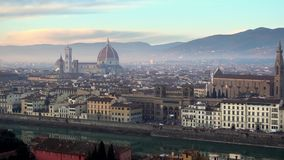 FLORENCE in Italy with the dome and Palazzo della Signoria and arno river. Panorama of the city of FLORENCE in Italy with the dome and Palazzo della Signoria and stock video footage