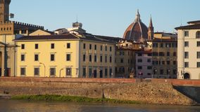 Florence Italy. Embankment of the Arno River. The dome of Cattedrale di Santa Maria del Fiore is visible stock video