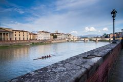 FLORENCE, ITALY - January 23, 2009: canoeists row on the river Arno near Ponte Vecchio Royalty Free Stock Image