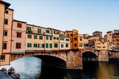 Famous Ponte Vecchio bridge with river Arno at sunset in Florence, Italy stock photos