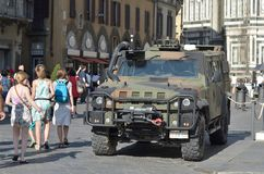 A Iveco fighting machine security in the city center, in Florence, italy, on 02 July 2017. FLORENCE, ITALY - JULY 02:2016; A Iveco fighting machine security in royalty free stock photography