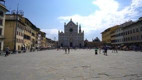 Basilica di Santa Croce di Firenze in the blazing midday sun. Florence,Italy-July 26,2018: Piazza Santa Croce and Basilica di Santa Croce di Firenze in the stock footage