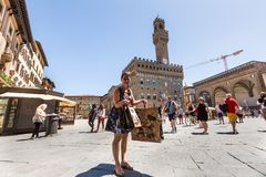 View of a girl shopping in Florence in Italy royalty free stock photos