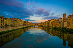 FLORENCE, ITALY - JUNE 12, 2015: Beautiful colors on the sky, sunset, at the end the Old Bridge or Ponte Vecchio on Royalty Free Stock Image