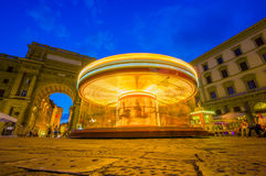 FLORENCE, ITALY - JUNE 12, 2015: Carousel at night iluminated in the middle of the square in Florence. Unidentified Stock Image