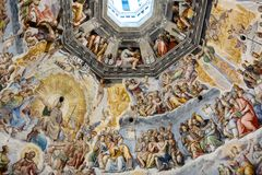Interior of Il Duomo Cathedral. Florence, Italy, June 13, 2015: Interior of Il Duomo Cathedral, with magnificent art work on the ceiling, Florence, Italy royalty free stock photo