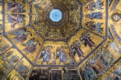 Interior of Il Duomo Cathedral. Florence, Italy, June 13, 2015: Interior of Il Duomo Cathedral, with magnificent art work on the ceiling, Florence, Italy stock image