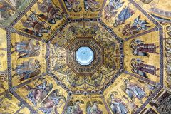 Interior of Il Duomo Cathedral. Florence, Italy, June 13, 2015: Interior of Il Duomo Cathedral, with magnificent art work on the ceiling, Florence, Italy royalty free stock photography