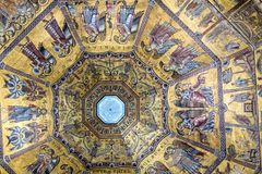 Interior of Il Duomo Cathedral. Florence, Italy, June 13, 2015: Interior of Il Duomo Cathedral, with magnificent art work on the ceiling, Florence, Italy stock photography