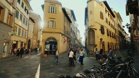 Florence, Italy, June, 2017: Narrow streets of Florence before the sunset. Tourists and locals rush about their business stock footage