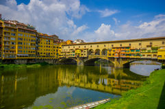 FLORENCE, ITALY - JUNE 12, 2015: Nice day view of old Bridge or Ponte Vecchio in Florence, pintureque place to shop and Royalty Free Stock Image