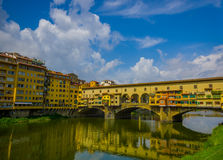FLORENCE, ITALY - JUNE 12, 2015: Nice day view of old Bridge or Ponte Vecchio in Florence, pintureque place to shop and. Visit Royalty Free Stock Image