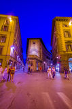 FLORENCE, ITALY - JUNE 12, 2015: People walking late at night on summer in Florence, lights on purple tone Royalty Free Stock Photo