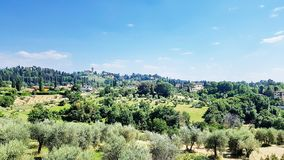 Tuscany landscape in Florence, Italy. FLORENCE, ITALY - JUNE 1, 2017: This scene in Florence is a perfect example of a hilly, serene and peaceful Tuscany stock photos