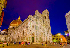 FLORENCE, ITALY - JUNE 12, 2015: Sunset in front of Florence Cathedral, blue sky contrasts and luminated building Stock Photos