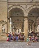 Tourists walking and shopping in the historic Mercato del Porcellino in Florence. Florence, Italy, June 2015: tourists and Florentines walking and shopping in Stock Photography