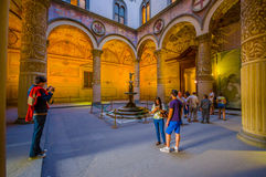 FLORENCE, ITALY - JUNE 12, 2015: Turists walking around main yard of Old Palace or Palazzo Vecchio in Florence Royalty Free Stock Images