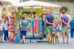 FLORENCE, ITALY - JUNE 12, 2015: Unidentified people looking for some souvenirs, tourists searching a perfect gift or a Royalty Free Stock Photography