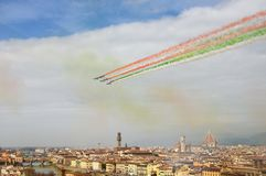 Florence, Italy - March, 28 2018: Airshow of PAN Frecce Tricolori. The Frecce Tricolori in the sky of Florence for 95th birthday of the Italian Air Force in Royalty Free Stock Photography