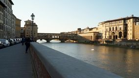 Embankment of the Arno River in Florence. The Ponte Vecchio bridge. Florence, Italy - March 22, 2018: Embankment of the Arno River in Florence. The Ponte Vecchio stock video