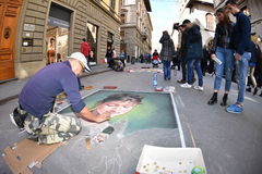 FLORENCE, ITALY - MARCH 27 2017 - Pavement artist painting on the streets. They are called Madonnari because of thei religous subject like the virgin Mary Stock Photo
