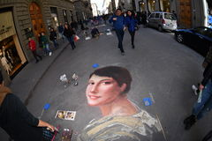 FLORENCE, ITALY - MARCH 27 2017 - Pavement artist painting on the streets. They are called Madonnari because of thei religous subject like the virgin Mary Stock Photos