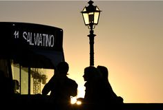 The bus, the lamppost and the silhouettes royalty free stock photos