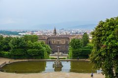 Florence, Italy - May 21, 2018: View on Fountain of Neptune and Boboli Garden with the back facade of Palazzo Pitti. Сloudy and stock photo