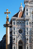 FLORENCE, ITALY - NOVEMBER, 2015: Ancient cross in front of the cathedral of Santa Maria in Fiore stock photo