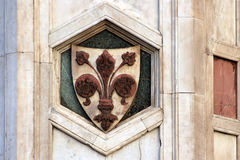 FLORENCE, ITALY - NOVEMBER, 2015: Florence city coat of arms in front of the Giotto bell tower Royalty Free Stock Image