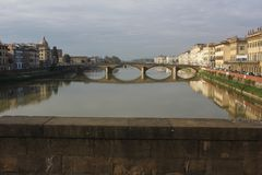 Frontal view of Carraia bridge in Florence. FLORENCE, ITALY - NOVEMBER 25 2015: Frontal view of Carraia bridge in Florence on Arno river, with its reflection on Stock Image