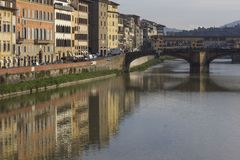 Renaissance building on Florence riverbank. FLORENCE, ITALY - NOVEMBER 25 2015: Renaissance building on Florence riverbank, with an historic bridge Royalty Free Stock Images