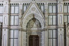 Close up of the doorway of Holy Cross church in Florence Royalty Free Stock Image