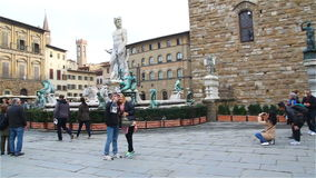 Florence, Italy - October 2016: tourists visiting the sights in the square near the palace Vecchio in Florence stock video