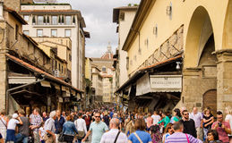 FLORENCE, ITALY. People walk on the famous Ponte Vecchio one of Florence's oldest and most photographed bridges Royalty Free Stock Image
